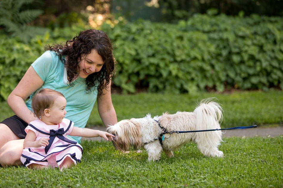 Baby photographer shoots baby and dog
